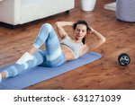woman workout at home  her sit... | Shutterstock . vector #631271039