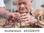 nurse giving medication to an... | Shutterstock . vector #631328195