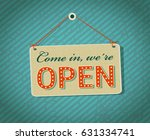 come in we're open sign board.... | Shutterstock .eps vector #631334741