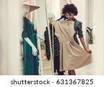 beautiful afro american girl is ... | Shutterstock . vector #631367825