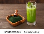 green smoothie with spirulina... | Shutterstock . vector #631390319