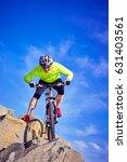 cyclist in helmet with mountain ... | Shutterstock . vector #631403561