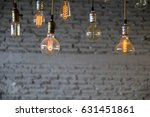 many bulbs with brick background | Shutterstock . vector #631451861