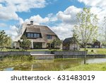 dutch suburban area with modern ... | Shutterstock . vector #631483019