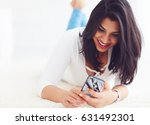 beautiful  indian girl surfing...   Shutterstock . vector #631492301