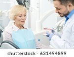 mature male dentist working... | Shutterstock . vector #631494899