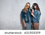 two stylish hipster girls in... | Shutterstock . vector #631503359