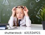 schoolgirl in glasses | Shutterstock . vector #631526921