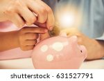 happy mother and kid put coins... | Shutterstock . vector #631527791