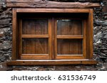 old wooden window on the stone... | Shutterstock . vector #631536749