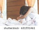 woman sit on a bed in a bedroom ... | Shutterstock . vector #631551461