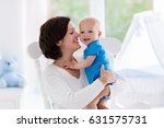 mother and baby at home. young... | Shutterstock . vector #631575731