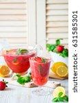 strawberry lemonade or cocktail | Shutterstock . vector #631585301