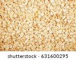 oat flakes on a light wooden... | Shutterstock . vector #631600295