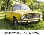 old yellow car in the middle of ... | Shutterstock . vector #631604951