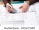 architect woman at her table... | Shutterstock . vector #631617689