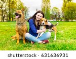 Stock photo girl with dogs on a walk 631636931