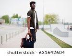portrait of walking stylish... | Shutterstock . vector #631642604