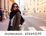 young woman thinking in the city | Shutterstock . vector #631643195