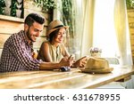 young couple using mobile... | Shutterstock . vector #631678955