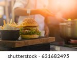 the chef is fried french fries... | Shutterstock . vector #631682495