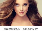 brunette  girl with long  and ... | Shutterstock . vector #631684949