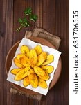 Small photo of Fried slices of ripe plantains, a traditional and popular snack and accompaniment in Central America and Northern South America, photographed overhead on dark wood with natural light