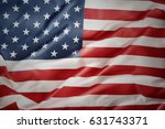 closeup of rippled american flag | Shutterstock . vector #631743371