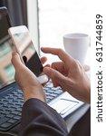 close up businessman hand using ...   Shutterstock . vector #631744859