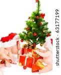 christmas kids in santa hats | Shutterstock . vector #63177199