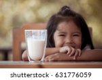 a glass of milk on table with... | Shutterstock . vector #631776059