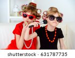 two funny little girls with... | Shutterstock . vector #631787735