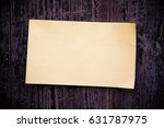 old brown paper on wood board... | Shutterstock . vector #631787975