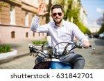 cheerful young man in helmet is ... | Shutterstock . vector #631842701