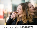 young woman biting tasty donut... | Shutterstock . vector #631870979