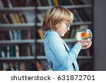 little child with goldfish | Shutterstock . vector #631872701