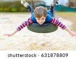 funny kid boy having fun with... | Shutterstock . vector #631878809