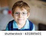 portrait of little cute school... | Shutterstock . vector #631885601