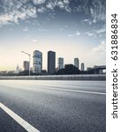 empty asphalt road of a modern... | Shutterstock . vector #631886834