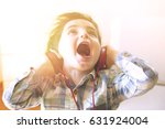 funny child listens to music... | Shutterstock . vector #631924004