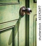 old iron doorknob on old green...   Shutterstock . vector #63192697