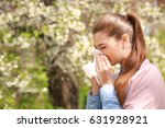 sneezing young girl with nose... | Shutterstock . vector #631928921