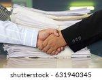 businessmen shake hands and...