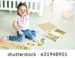 asian little girl playing... | Shutterstock . vector #631948901