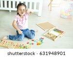 asian little girl playing...   Shutterstock . vector #631948901