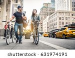 couple of cyclist in new york   ... | Shutterstock . vector #631974191
