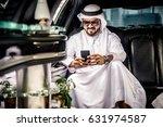 arabic businessmen in dubai | Shutterstock . vector #631974587
