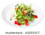 appetizer - salad with tomato and cucumber on white plate - stock photo