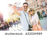 couple of tourists... | Shutterstock . vector #632034989