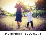 mother with her little son   | Shutterstock . vector #632036375